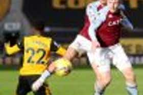 Article image: https://image-service.onefootball.com/resize?fit=max&h=1080&image=https%3A%2F%2Fwww.footballfancast.com%2Fwp-content%2Fuploads%2F2020%2F12%2FAston-Villas-Matt-Targett-and-Jack-Grealish-in-action-with-Wolverhampton-Wanderers-Nelson-Semedo-100x100.jpg&q=25&w=1080